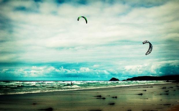 kite surfers on the beach
