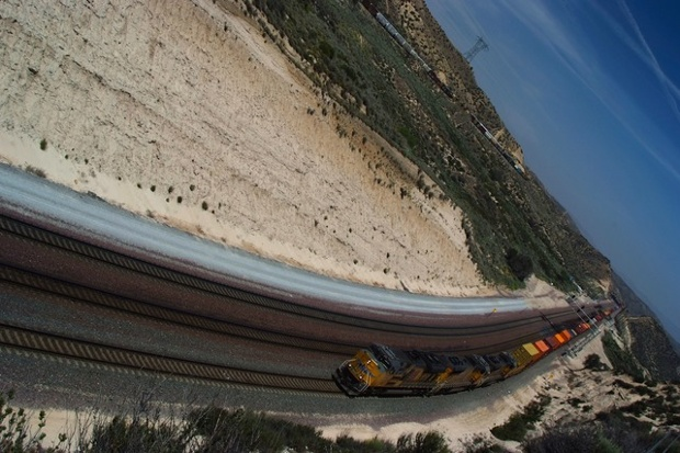 a freight train pulling cargo along a railway track
