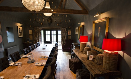 Long tables and hanging lamps at the Wheatsheaf Inn
