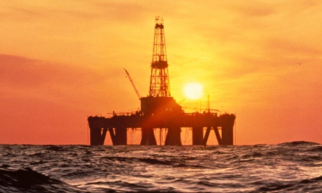 Offshore drilling rig with sunset in North Sea