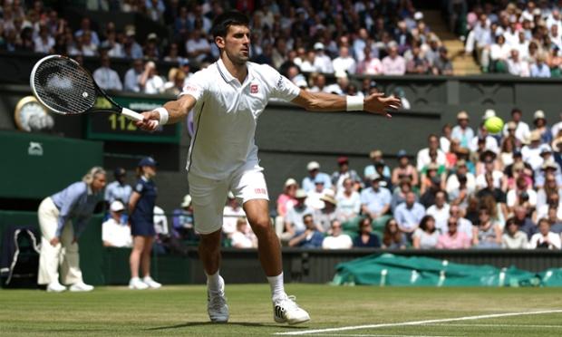Serbian Novak Djokovic returns the ball in his match against France's Gilles Simon on day five.