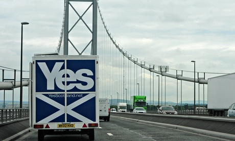 A Yes Scotland caravan drives over the Forth bridge.