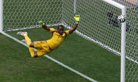 Enyeama athletically tips the ball away.