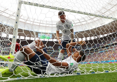 Raphael Varane is assisted by Mathieu Debuchy as lies hurt in the net.