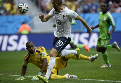 Karim Benzema chips the ball over Vincent Enyeama...