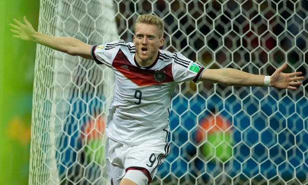 André Schürrle of Germany celebrates after scoring a goal during the first period of extra time against Algeria.