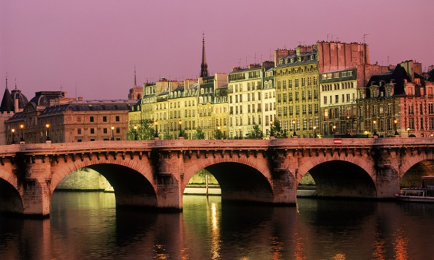 Pont Neuf over River Seine at night in Paris.