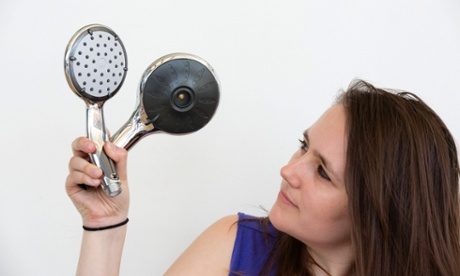 Erica Buist tests out eco shower heads