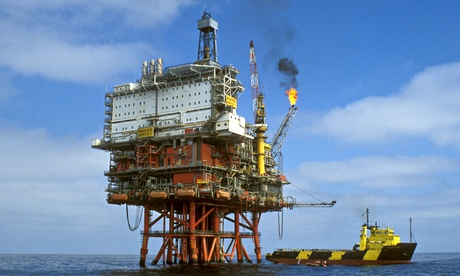 Oil and gas production platform in the North Sea with burning flames