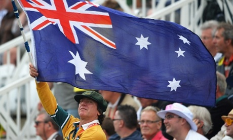 An Australian fan flies the national flag.