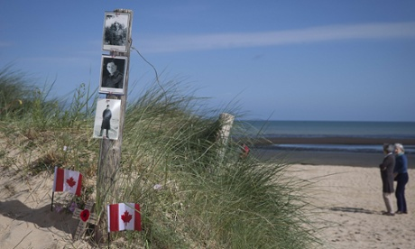 Canadian flags and portraits of Canadian soldiers Albert and Franck Maloney – killed here at Juno beach on June 6, 1944 – at Courseulles-sur-mer.