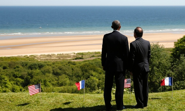 US President Barack Obama and French President Francois Hollande look out over Omaha Beach.