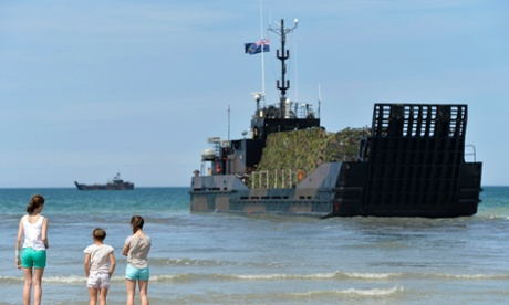 D-day landing craft in the sea at Gold Beach at Arromanches-les-Bains on the Normandy coast.
