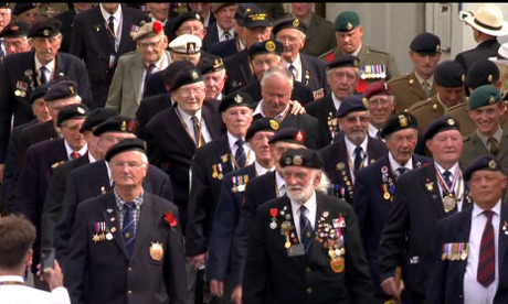 Veterans march at Arromanches.