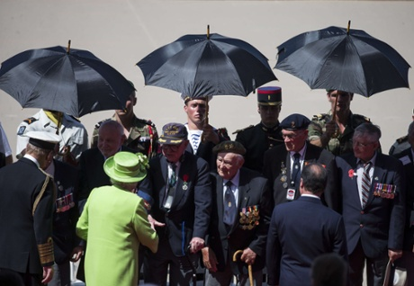 The Queen greets veterans during an international D-day commemoration ceremony on the beach of Ouistreham.