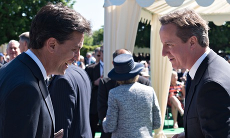 Prime minister David Cameron speaks with Labour leader Ed Miliband