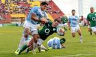 Jonny Sexton goes over for Ireland's second try despite the efforts of Argentina's Manuel Montero.