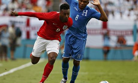 Daniel Sturridge dribbles past Honduras' Wilson Palacios in England's friendly in Miami.