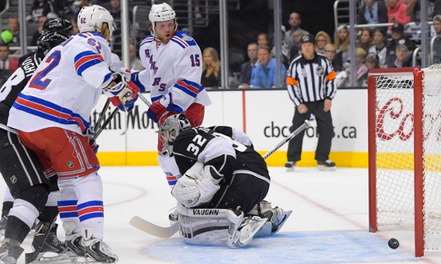 Ryan McDonagh's shot rolls past Los Angeles Kings goalie Jonathan Quick during the first period of Game 2 in the NHL hockey Stanley Cup Finals.
