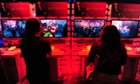 Gamers play Playstation 3's Hitman Absolution on the third day of the E3 videogame extravaganza in Los Angeles, California.