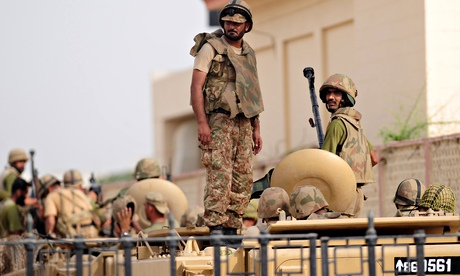 Pakistani army personnel stand guard at Karachi's airport