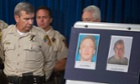 Clark County sheriff Doug Gillespie looks at photos of shooting suspects Jerad and Amanda Miller during a news conference.