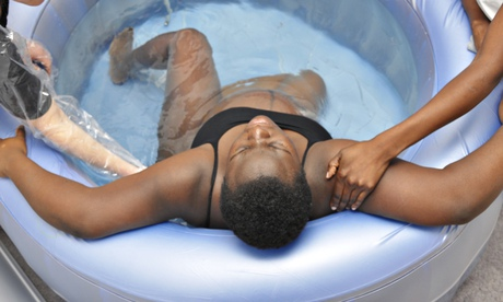 A woman in labour using a birthing pool
