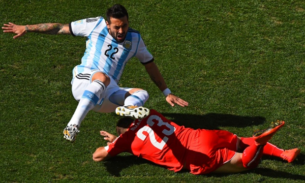 Ezequiel Lavezzi of Argentina is challenged by Xherdan Shaqiri.