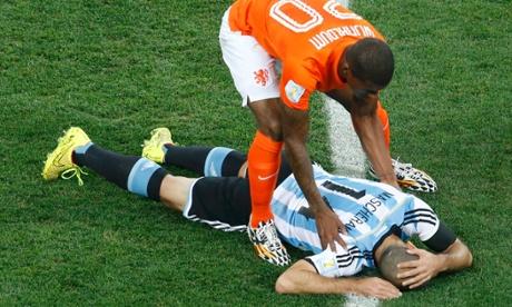 Georginio Wijnaldum of the Netherlands checks on Argentina's Javier Mascherano.