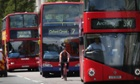 A cyclist passes buses in Oxford Street, London. The city is one of several UK urban areas in breach of EU pollution limits for nitrogen dioxide