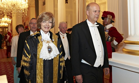 Chris Grayling, with pre-tied tie, accompanies the lord mayor of London, Fiona Woolf at the judges'