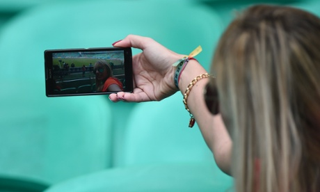 Woman taking selfies with phone
