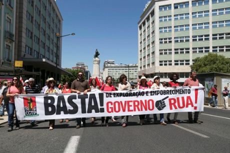 Public service workers affiliated with the CGTP-IN trade union hold a banner with the words 'Enough! Of Exploration and Impoverishment. Government Out' during a protest in defense of collective bargaining, an increase in the minimum wage, improvement of salaries and pensions, health, education and social security and for the resignation of the government, in Lisbon, Portugal, 10 July 2014.