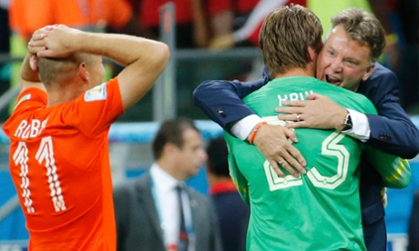 Louis van Gaal embraces Holland penalty expert Tim Krul.