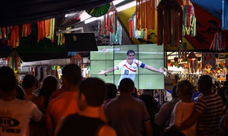 Fans in Brazil watch Fulham's Bryan Ruiz score against Greece.