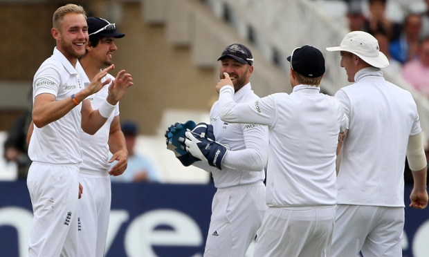 England's Stuart Broad celebrates after taking the wicket of Virat Kohli.