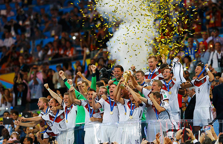 footy -: Germany's players lifts the World Cup trophy