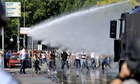 Police using water cannon in Albania