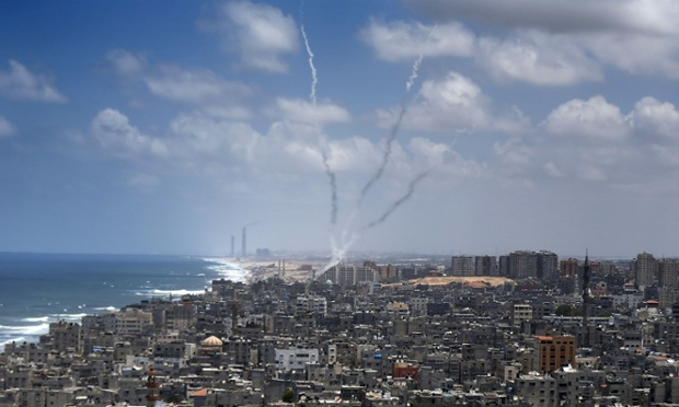 Smoke from rockets fired from near Gaza City. israel palestine