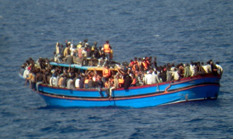 A boat overcrowded with migrants travelling from Libya