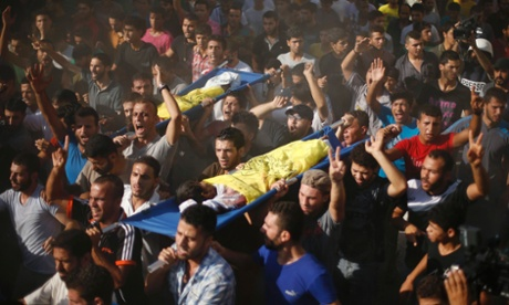 Palestinians carry the bodies of two boys from the Bakr family, whom medics said were killed with other two children from the same family by a shell fired by an Israeli naval gunboat.