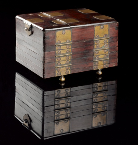 A Japanese wood and glass pillow book, hinged and folded like a concertina, opening into six leaves, with twelve pictures painted on glass, complete with a mirror
