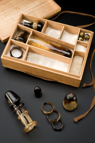 Collection of sexual aids, with instructions, in wooden box, by Arita Drug and Rubber Goods Company, Kobe, Japan, 1930 to 1935