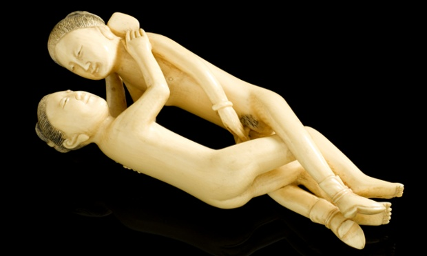 Far Eastern carved ivory statue, in the form of a copulating man and woman