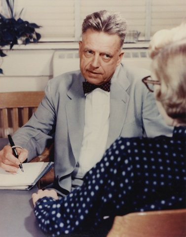 Alfred Kinsey interviewing a woman.