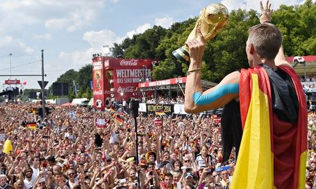 Fans cheer midfielder Bastian Schweinsteiger in Berlin after Germany's World Cup triumph. Photograph: Markus Gilliar/AP