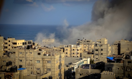 Smoke rises after an Israeli missile strike on July 16, 2014 in Gaza City, Gaza Strip.