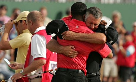 Tiger Woods cries with his caddie, Steve Williams