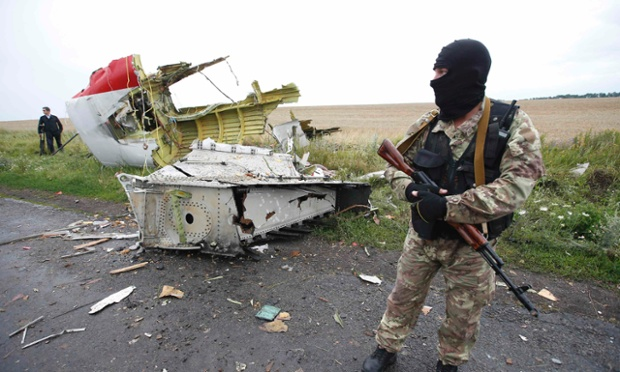 A separatist stands at the crash site of Malaysia Airlines flight MH17, near the settlement of Grabovo. ukraine