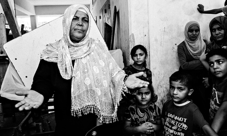 A family who fled to safety in an UNRWA school opened as a refuge in Jabaliya in Gaza.